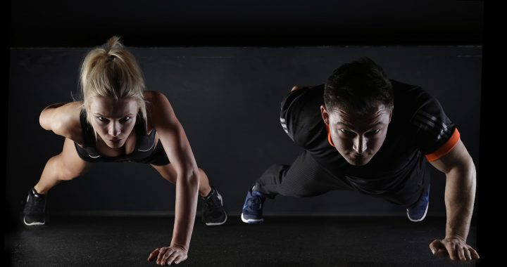 a couple doing pushups together